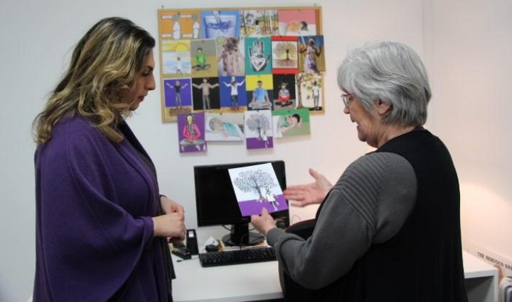 Lyn showing Nasim the new self care cards
